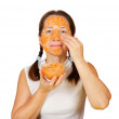 Mature woman making bio cosmetic pack - Photo