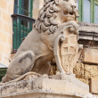 Sculpture of lion with  Valletta emblem - Stock fotografie