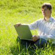 Stock Photo: Man with laptop outdoor