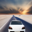 White car on desert road — Stock Photo