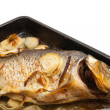 Grilled carp fish on the griddle over white — Stock Photo