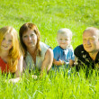 Parents with children in grass — Stock Photo