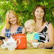 Family having tea — Stock Photo