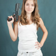 Young woman posing with gun — Stock Photo
