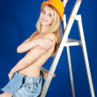 Stock Photo: Topless girl in hardhat on stepladder