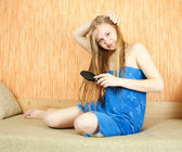 Girl combing her long hair — Stock Photo
