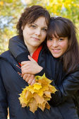 Girls in autumn park — Stock Photo