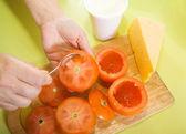 Closeup of making stuffed tomato — Stock Photo