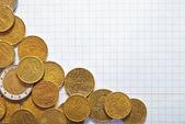 Hintergrund der münzen auf pad — Stockfoto