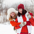 Miling girls in winter — Stock Photo