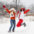 Girls is jumping at winter park — Stock Photo
