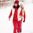 Stock Photo: Girls runs at winter park