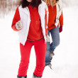Girls runs at winter park — Stock Photo