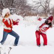 Girls plays with snow — Stock Photo