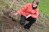 Woman resetting tree sprouts — Stock Photo
