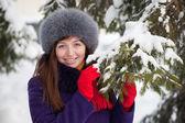 Woman near fir-tree in winter — Stock Photo