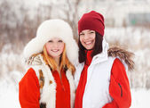 Smiling girls in winter — Stock Photo