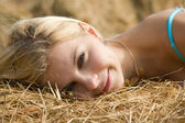 Blonde girl on hay — Stock Photo