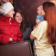 Mother with baby is meeting a kinsfolk - Foto Stock
