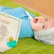 Stock Photo: Baby with certificate of birth