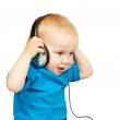 Stock Photo: Little boy listening to music