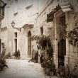 Retro photo of old narrow  street - Stock Photo