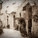 Retro photo of old narrow street — Stock Photo