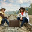 Pretty girls sitting on rail — Stock Photo