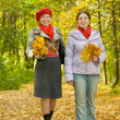 Mother with adult daughter in autumn — Stock Photo