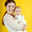 Happy mother with 2 month baby — Stock Photo #4833094