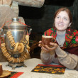 Woman near  traditional russian samovar — Stock Photo