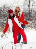 Happy girls in winter park — Stock Photo