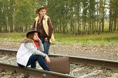 Girls walking along railroad — Stock Photo