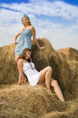 Girls resting on hay — Stock Photo
