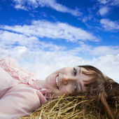 Girl resting against sky — Stock Photo