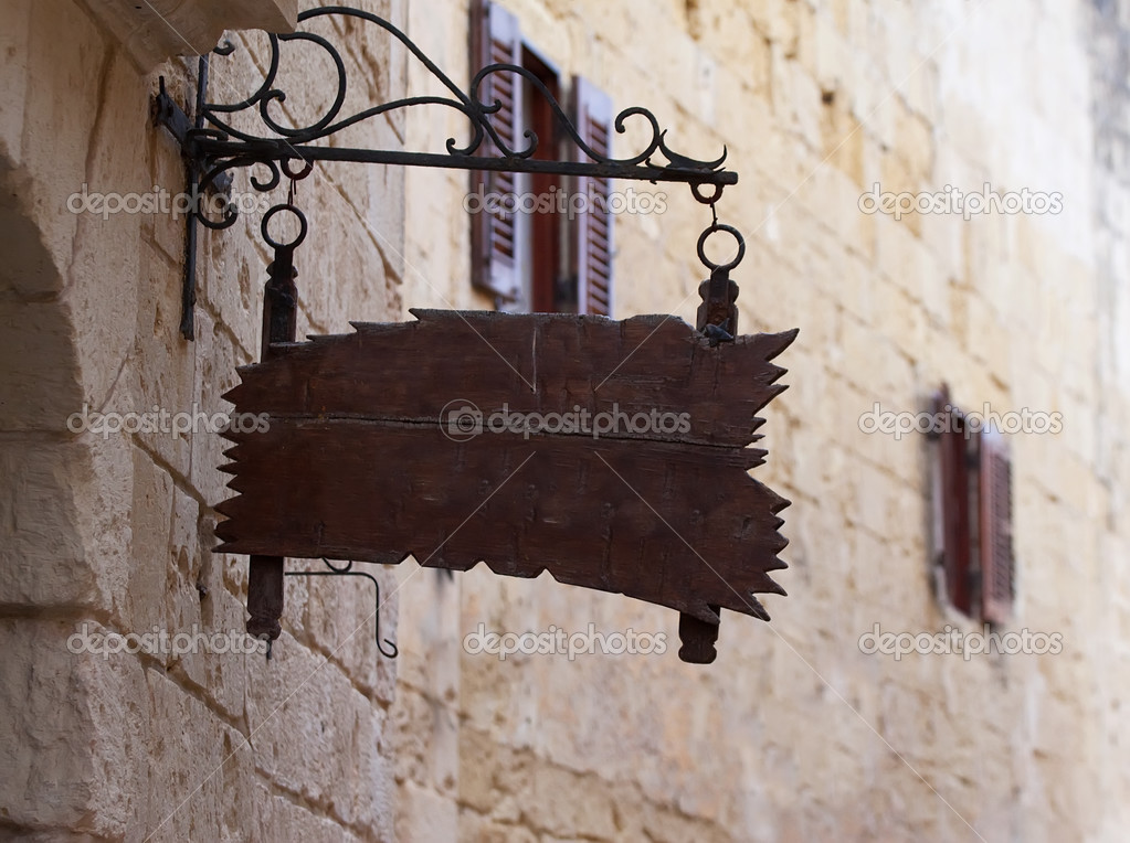 Old wooden  plaque on wall old mediterranean street  Stock Photo #4833903