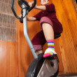 Woman working out  on spinning bike — Stock Photo
