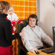 Wife and daughter disturbs man — Stock Photo