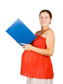 Pregnant girl reads paper folder — Stock Photo