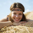 Girl on straw — Stock Photo