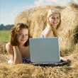 Girls with notebook in farm — Stock Photo