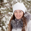 Girl in wintry pine forest — Stock Photo #5150250