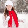 Sporty woman runs in winter — ストック写真