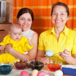 Happy family coloring easter eggs — Stock Photo