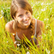 Teenager girl lying at  grass — Stock Photo