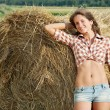 Girl on fresh straw — Stock Photo #5152671