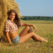 Girl on fresh straw — Stock Photo #5152676