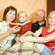 Stock Photo: Family reading book at home