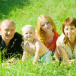 Happy family of 4 — Stock Photo #5152737