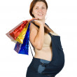 Stock Photo: Pregnant womwith shopping bags